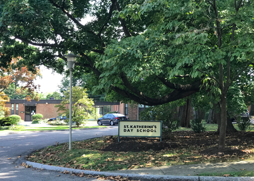 St Katherine Day School front sign by trees and driveway